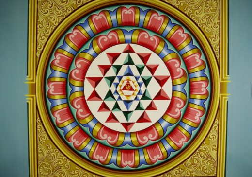 A_Yantra_with_Tamil_Om_symbol_in_center,_at_a_Mariamman_Temple